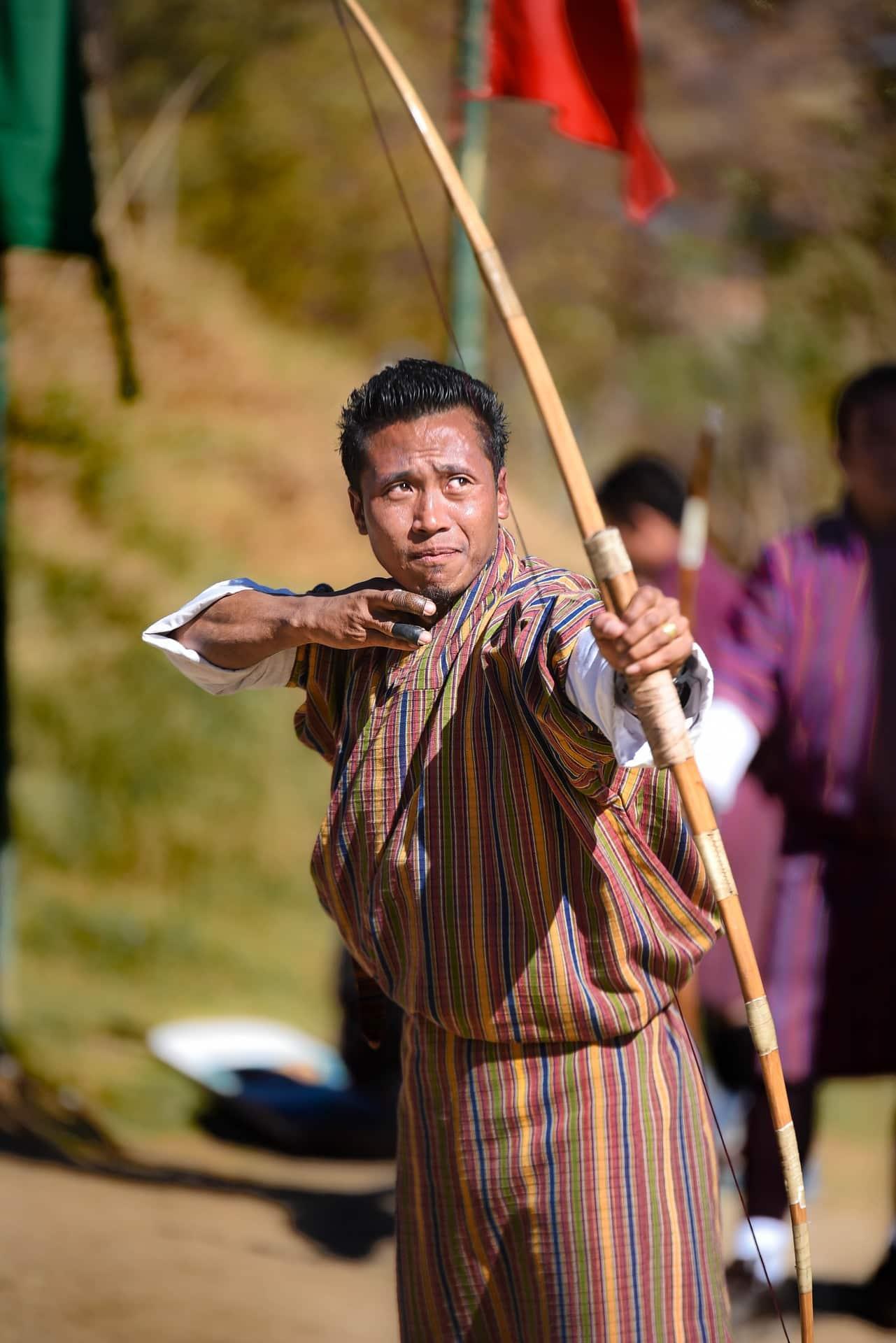 Man with an archer in Bhutan Archery adventure